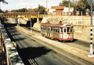 A tram goes through the Goodwood underpass
