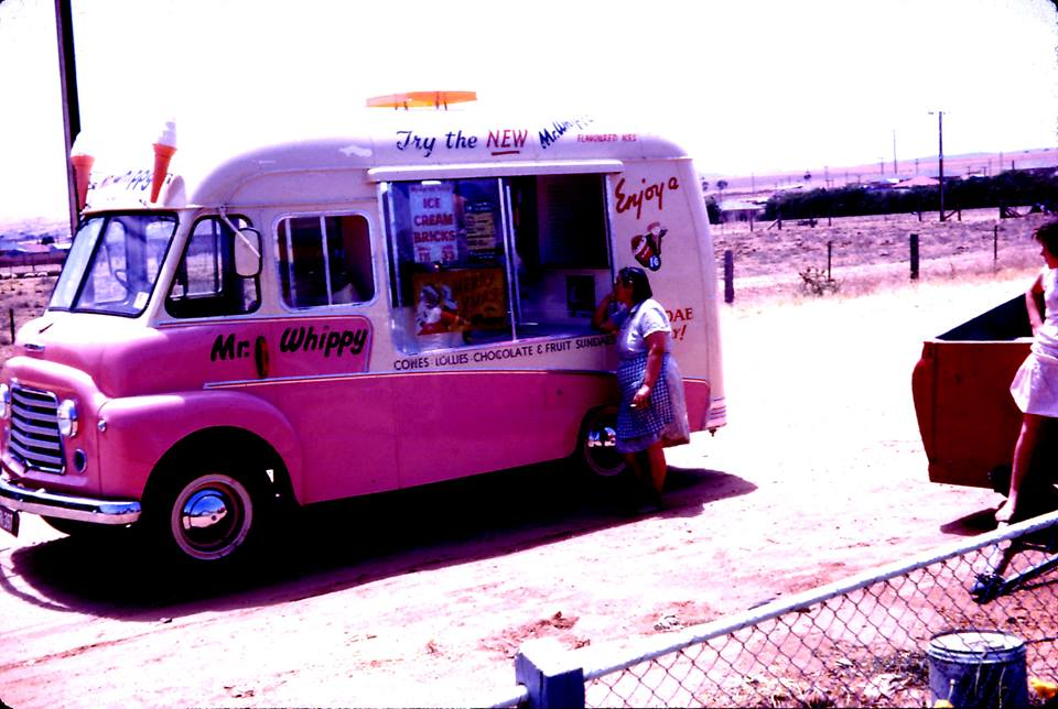"Photo courtesy of Mark Foy; ""Here is a picture of My Mum at the Mr Whippy Van outside of our house in Pratt Avenue Pooraka in the very late 50's or very early 60's - It must have been summer and near Christmas looking at the advertising on the van. This before Pooraka was developed and was largely farms and paddocks"""