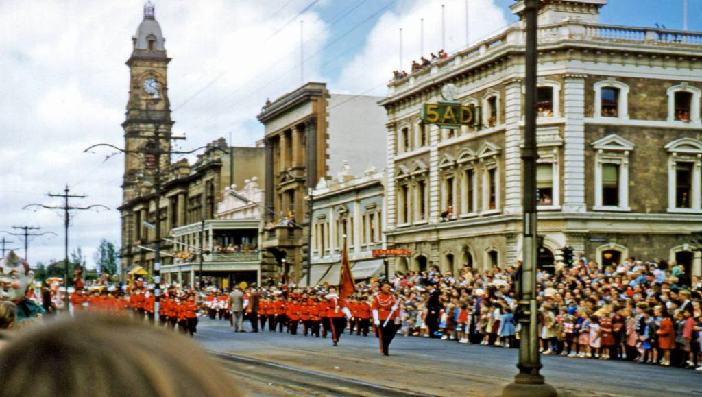 Photo courtesy of Ken Taylor. Johnnies 1957 pageant marches past the old 5AD building in King William Street