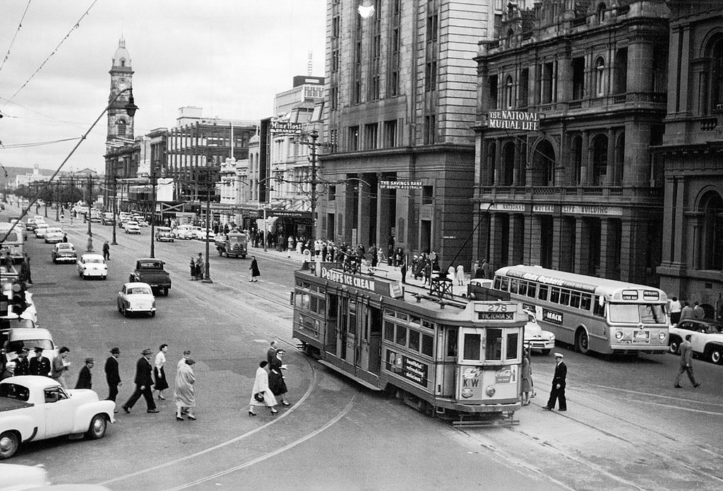 Photo from ARW FB page. A tram conductor waits as passengers board a tram in King William Street in the 1950s