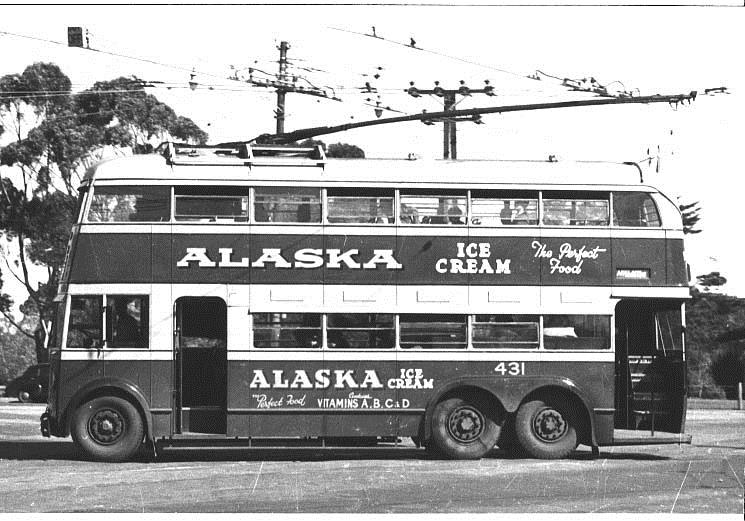 Photo from Wikipedia Commons. Double Decker Trolley Bus 1940s showing the front and rear entrances. Love the old advertising for Alaska Ice Cream, The Perfect Food!