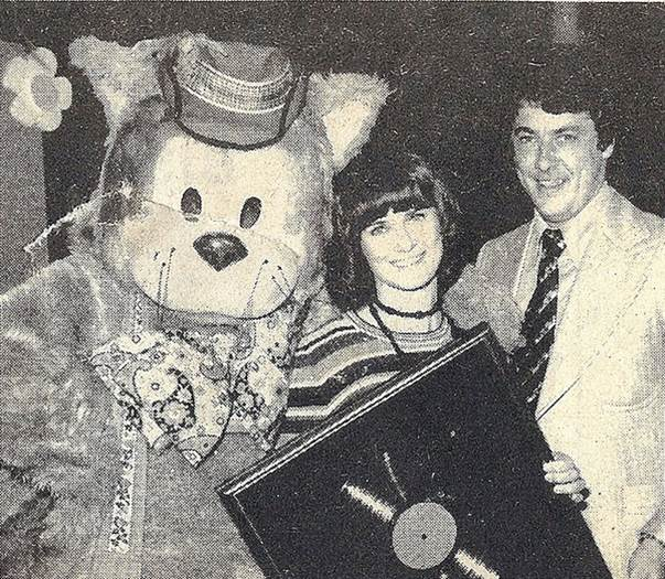 "This newspaper photo from 1973 is from Patsy's own Photostream on Flickr and shows Fat Cat, Patsy and Noel O'Connor, fellow presenter on Channel 10, just after Patsy had been presented with a gold album award for her LP ""Fifty Favourite Nursery Rhymes""."