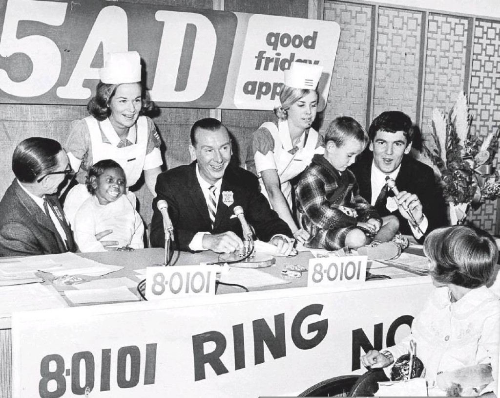 Photo from the Advertiser. The Good Friday Appeal 1967 was broadcast live from the Adelaide Children's Hospital. The panel includes 5AD Doghouse Club kennel masters, Len Sweeney, Bert Day and Barry Ion together with nurses Sue Macklin and Deanne Grundy