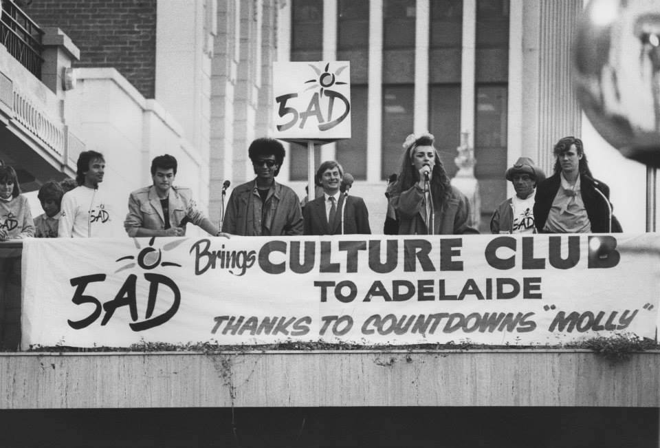 "Photo posted by Greg Clark of Boy George's visit to Adelaide in 1984 ""with myself, Jon Moss, Mikey Craig, John Bannon, Boy George, Ian Molly Meldrum and Roy Hay."""