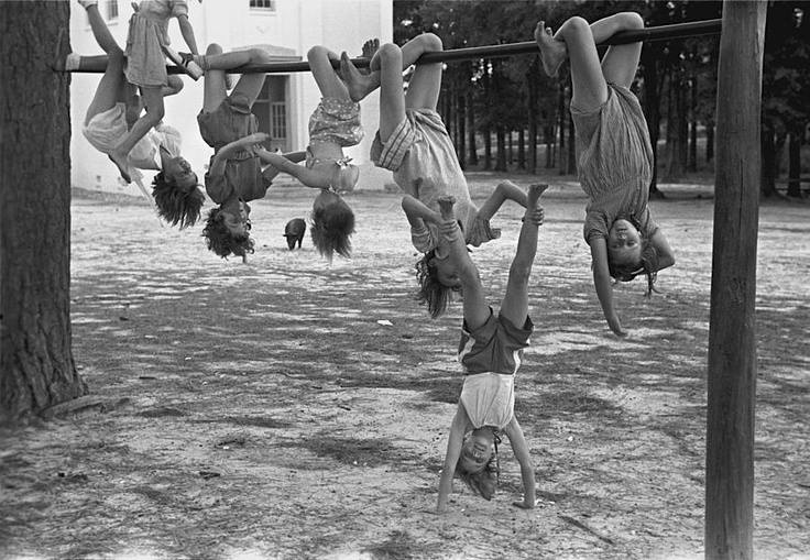 kids hanging upside down in playground