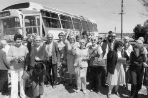 Off for a fun weekend. People about to board a bus to take them to a daytrip pokies tour to the Coomealla Memorial Club in Dareton, in 1983.