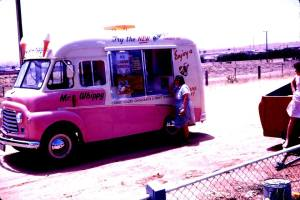 """Photo courtesy of Mark Foy; """"Here is a picture of My Mum at the Mr Whippy Van outside of our house in Pratt Avenue Pooraka in the very late 50's or very early 60's - It must have been summer and near Christmas looking at the advertising on the van. This before Pooraka was developed and was largely farms and paddocks"""""""