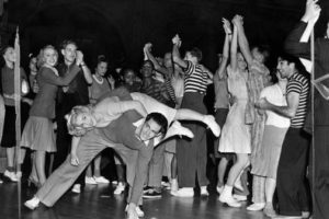 Teenagers jiving to rock'n'roll music in the 1950s