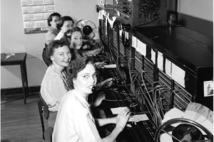 Photo from Google Images. Manual switchboard operators at work in 1952
